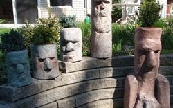 fake rock moai head statues